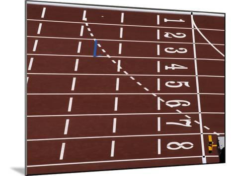 Track Lane Numbers at the Finish Line-Paul Sutton-Mounted Photographic Print
