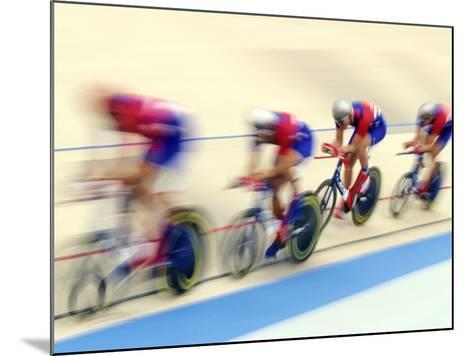 Blurred Action of Cycliing Team Onthe Track-Chris Trotman-Mounted Photographic Print