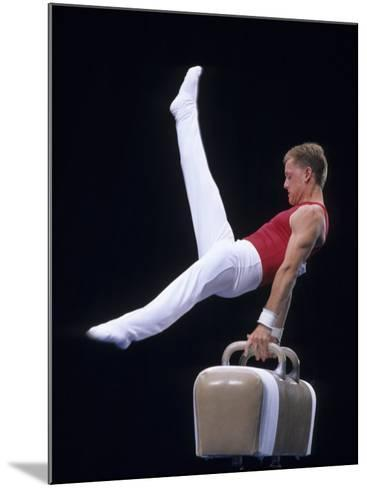 Male Gymnast Performing on the Pomell Horse--Mounted Photographic Print