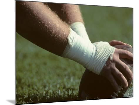 Football Center About to Snap the Ball-Paul Sutton-Mounted Photographic Print
