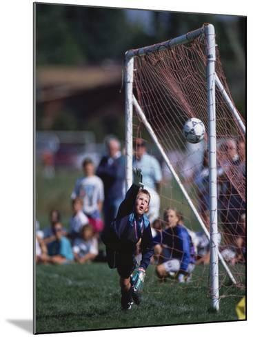 11 Year Old Boys Soccer Goalie in Action--Mounted Photographic Print