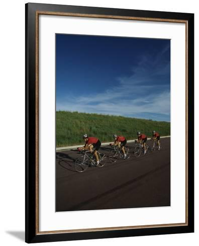 Road Cycling Team in Action--Framed Art Print