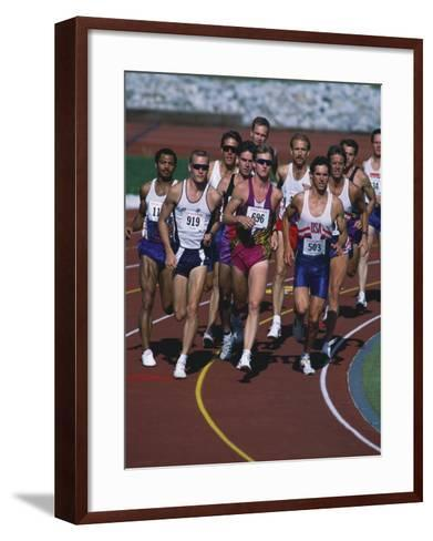 Male Runners Competing in a Track Race--Framed Art Print
