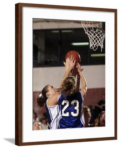 Female High School Basketball Players in Action During a Game--Framed Art Print