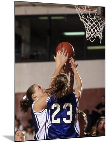 Female High School Basketball Players in Action During a Game--Mounted Photographic Print