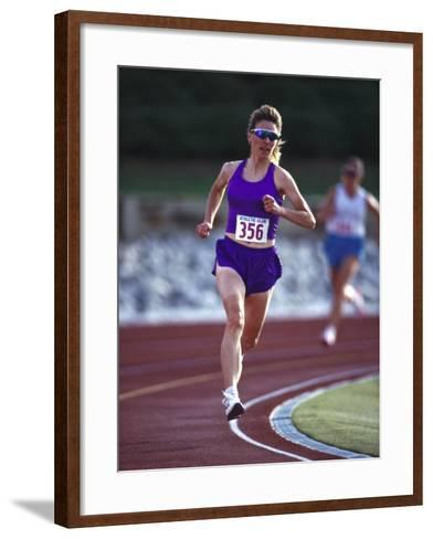 Female Runner Competing in a Track Race--Framed Art Print
