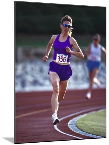Female Runner Competing in a Track Race--Mounted Photographic Print