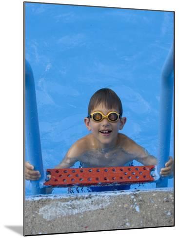 Portrait of 9 Year Old Boy in Swimming Pool, Kiamesha Lake, New York, USA-Paul Sutton-Mounted Photographic Print