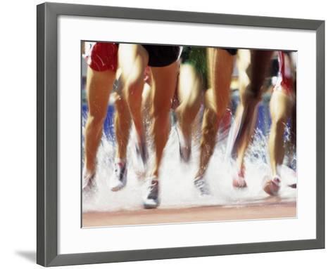 Runners Legs Splashing Through Water Jump of Track and Field Steeplechase Race, Sydney, Australia-Paul Sutton-Framed Art Print