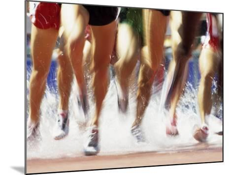 Runners Legs Splashing Through Water Jump of Track and Field Steeplechase Race, Sydney, Australia-Paul Sutton-Mounted Photographic Print