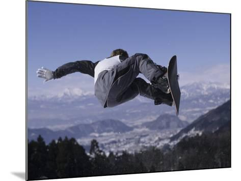 Male Snowboarder Flying over the Vert--Mounted Photographic Print