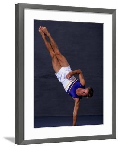 Male Gymnast Performing on the Floor Exercise--Framed Art Print