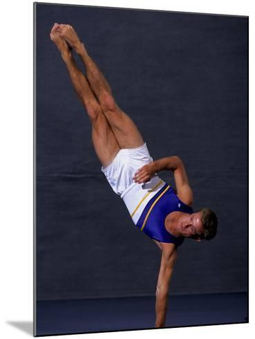 Male Gymnast Performing on the Floor Exercise--Mounted Photographic Print