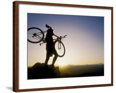 Silhouette of Mountain Biker at the Summit During Sunrise--Framed Art Print
