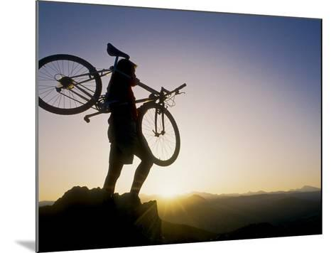Silhouette of Mountain Biker at the Summit During Sunrise--Mounted Photographic Print
