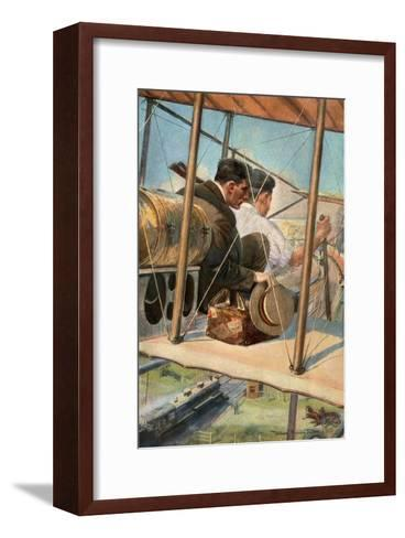 Biplane with Pilot and Passenger Flying Over a Locomotive, 1910--Framed Art Print