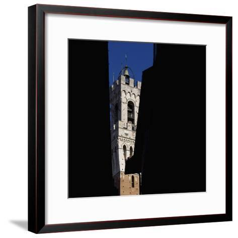 Siena Architectural Details. Glimpse of Crenellated Tower with Bell-Mike Burton-Framed Art Print
