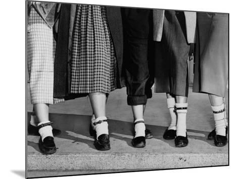 Legs and Feet with Dog Collar Anklets-Roger Higgins-Mounted Photo