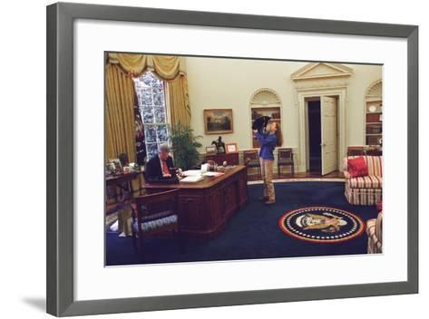 Chelsea Clinton Playing with Socks the Cat in the Oval Office--Framed Art Print