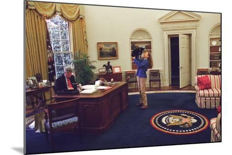 Chelsea Clinton Playing with Socks the Cat in the Oval Office--Mounted Photo