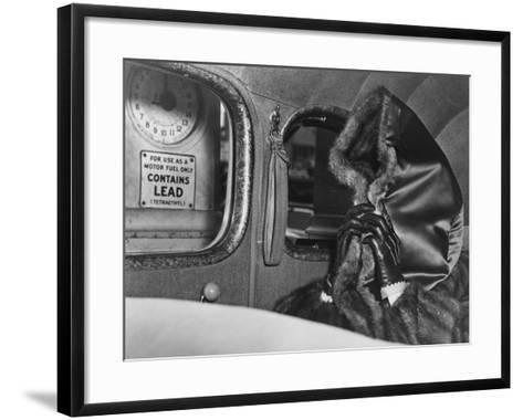 Mae Capone, Wife of Gangster Al Capone, Hides Her Face from Photographers with Hood of Her Fur Coat--Framed Art Print