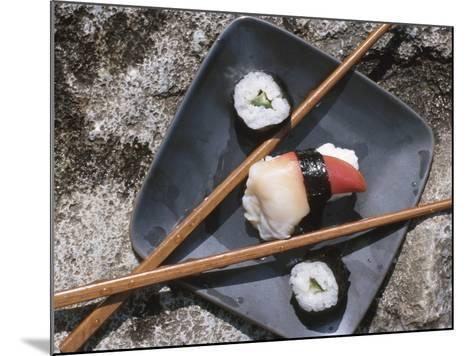 Sushi and Chopsticks Beside Rushing Water--Mounted Photographic Print