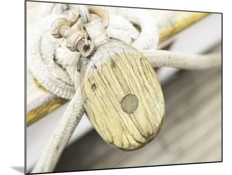 Wooden Pulley and Rope on Edge of Boat--Mounted Photographic Print
