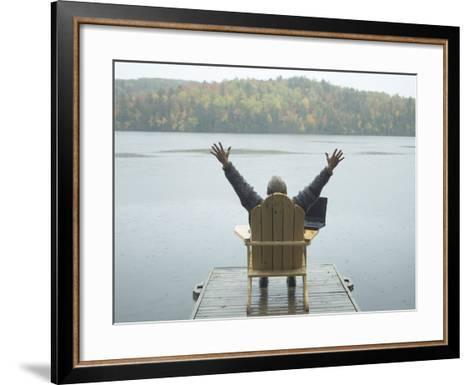 Man Sitting on a Dock with Arms Outstretched--Framed Art Print