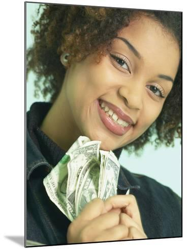 Woman Holding Money--Mounted Photographic Print
