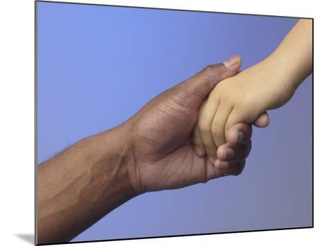 Adult Holding Child's Hand--Mounted Photographic Print