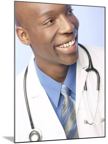 Smiling Doctor with Stethoscope Around His Neck--Mounted Photographic Print
