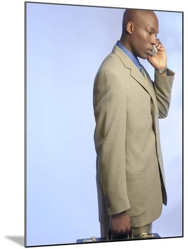 Businessman Talking on Cell Phone--Mounted Photographic Print