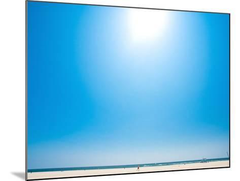 Bright Blue Sky with Sun Shining over a Beach--Mounted Photographic Print