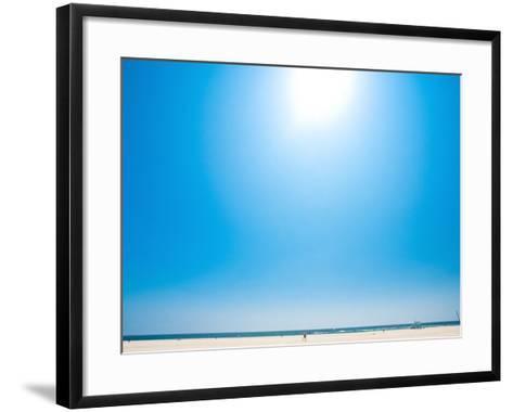 Bright Blue Sky with Sun Shining over a Beach--Framed Art Print