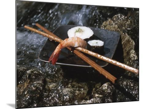 Elegant Sushi and Chopsticks Beside Rushing Water--Mounted Photographic Print