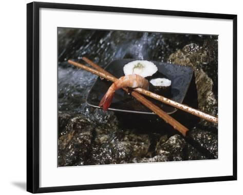 Elegant Sushi and Chopsticks Beside Rushing Water--Framed Art Print