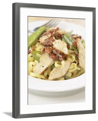 Silver Fork Beside Plate of Tasty Pasta with Sun Dried Tomatoes and Chicken--Framed Art Print