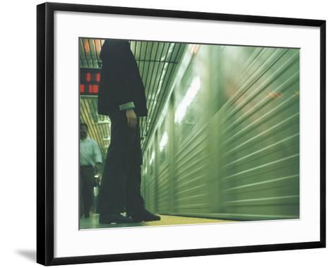Person Waiting For Subway--Framed Art Print