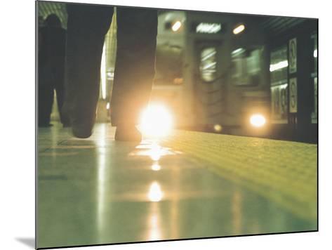 Person Walking Along Subway Platform--Mounted Photographic Print