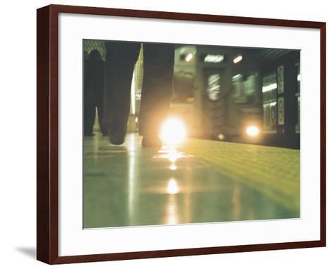 Person Walking Along Subway Platform--Framed Art Print