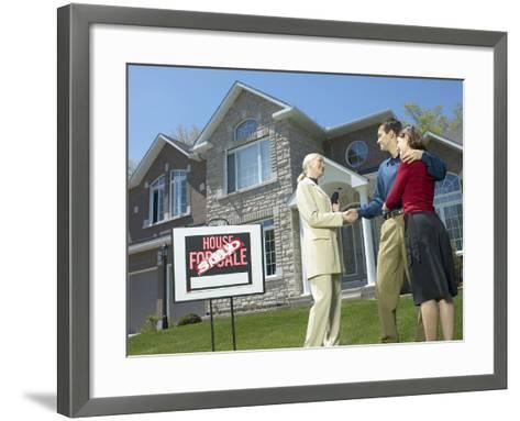 Real Estate Owner Selling Home to Young Couple--Framed Art Print