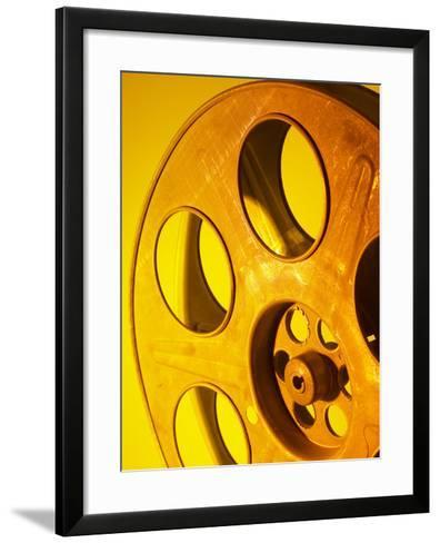Movie Film and Reels in Yellow Light--Framed Art Print