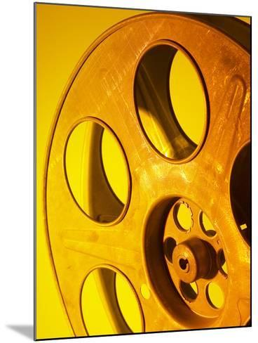 Movie Film and Reels in Yellow Light--Mounted Photographic Print