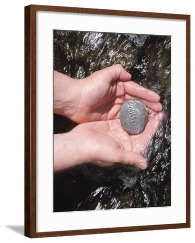 Person Holding Rock with the Word Blessings in Rushing Water--Framed Art Print
