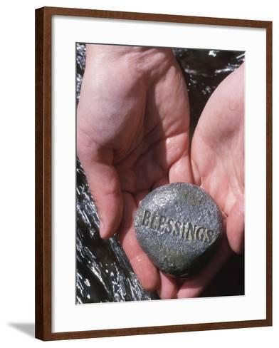 Person Holding Rock with the Word Blessings--Framed Art Print