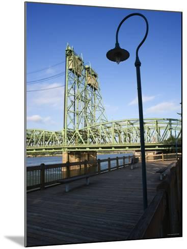 Boardwalk Along River with Industrial Bridge in the Background in Portland, Oregon--Mounted Photographic Print