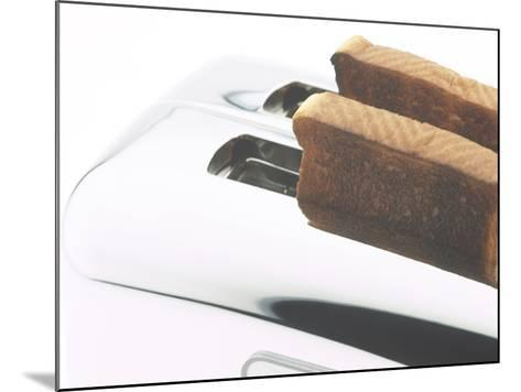 Toast Popping out of Sleek Stainless Steel Toaster--Mounted Photographic Print