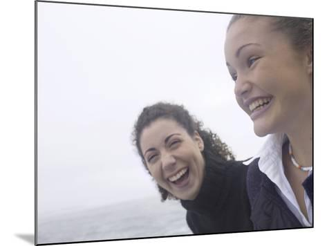 Giggling Women Standing on Edge of Water--Mounted Photographic Print