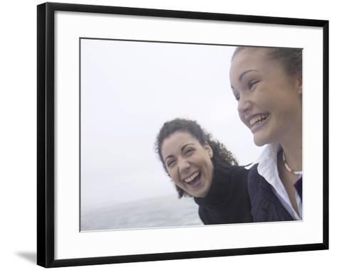 Giggling Women Standing on Edge of Water--Framed Art Print