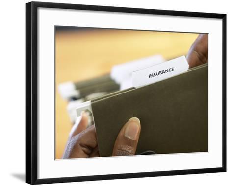 Woman Holding Insurance Folder--Framed Art Print